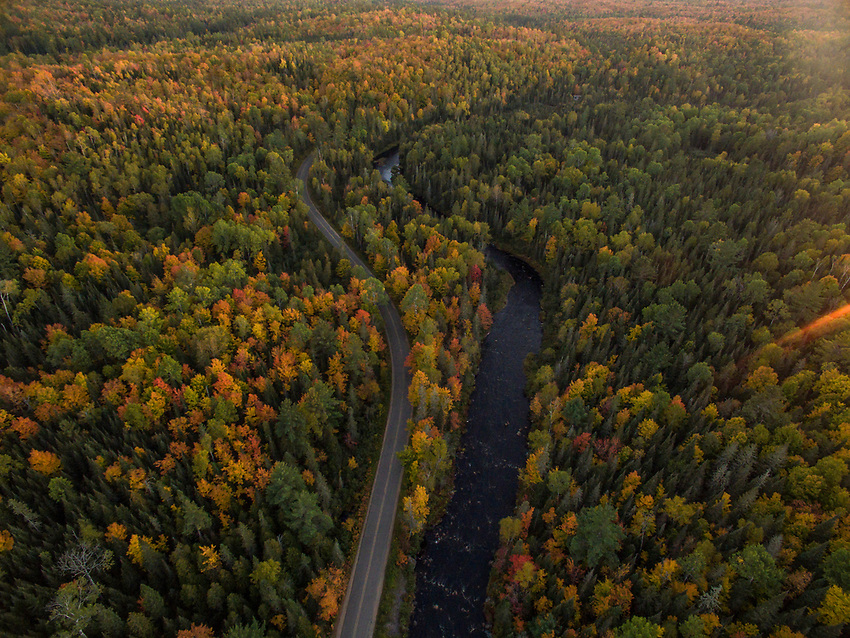 Aerial drone image of fall color in the Michigamme Highlands and Peshekee River of Marquette County, Michigan.