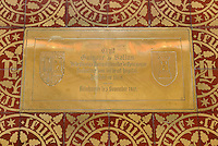 Memorial plaque marking the tomb of Guigone de Salins, 1403-70, on the tiled floor of the Chapel, in the Salle des Povres or Room of the Poor of Les Hospices de Beaune, or Hotel-Dieu de Beaune, a charitable almshouse and hospital for the poor, built 1443-57 by Flemish architect Jacques Wiscrer, and founded by Nicolas Rolin, chancellor of Burgundy, and his wife Guigone de Salins, in Beaune, Cote d'Or, Burgundy, France. The hospital was run by the nuns of the order of Les Soeurs Hospitalieres de Beaune, and remained a hospital until the 1970s. The building now houses the Musee de l'Histoire de la Medecine, or Museum of the History of Medicine, and is listed as a historic monument. Picture by Manuel Cohen