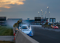 Jun 2, 2018; Joliet, IL, USA; NHRA funny car driver John Force crashes into the wall during qualifying for the Route 66 Nationals at Route 66 Raceway. Force would walk away from the crash. Mandatory Credit: Mark J. Rebilas-USA TODAY Sports