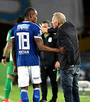 BOGOTA - COLOMBIA - 18 – 02 - 2018: Miguel Angel Russo (Der.), técnico, de Millonarios, da instrucciones a Jair Palacios (Izq.) jugador de Millonarios, durante partido de la fecha 4 entre Millonarios y Atletico Nacional, por la Liga Aguila I 2018, jugado en el estadio Nemesio Camacho El Campin de la ciudad de Bogota. / Miguel Angel Russo (R), coach of Millonarios, gives instructions to Jair Palacios (L) player of Millonarios, during a match of the 4th date between Millonarios and Atletico Nacional, for the Liga Aguila I 2018 played at the Nemesio Camacho El Campin Stadium in Bogota city, Photo: VizzorImage / Luis Ramirez / Staff.