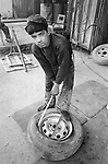 A twelve-year-old boy works as a mechanic in Kabul. Decades of external and internal warfare destabilized family structures, and literally turned its patriarchal culture upside-down. Millions of men have died, and families were displaced. Their children were given a new role within their own kin in providing financial support. Many children were literally forced to work, or street begging, redefining their status as adults.