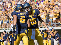 Chris Harper of California celebrates with California quarterback Jared Goff after Harper scored a touchdown during the game against Washington State at Memorial Stadium in Berkeley, California on October 5th, 2013.  Washington State defeated California, 44-22.