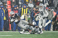 FOXBOROUGH, MA - NOVEMBER 24: New England Patriots Runningback Sony Michel #26 is tackled by Dallas Cowboys Cornerback Chidobe Awuzie #24 and Dallas Cowboys Safety Xavier Woods #25 during a game between Dallas Cowboys and New England Patriots at Gillettes on November 24, 2019 in Foxborough, Massachusetts.