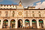 Piazza della Loggia with the 16th century clock tower with two figures on the top that strike the bell on the hour; Brescia, Italy