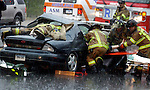 Town of Manchester, CT. Firefighters endure heavy rain as they work to free an unconscious woman from a car after removing the door on West Middle Tpke in Manchester Tuesday afternoon, April 13, 2004,after a 2 car accident during a heavy rain shower.  (AP Photo/Journal Inquirer, Jim Michaud)