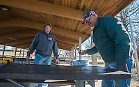 NWA Democrat-Gazette/ANTHONY REYES @NWATONYR<br /> Brent Rhoades, crew supervisor at Tyson Sports Complex, watches as Jerry Hamm, with Springdale Parks and Recreations department, paints a picnic table Wednesday, Feb. 15, 2017 in a pavilion at the Tyson Sports Complex in Springdale. The crew is testing a small section to paint in the cooler weather to see if it will dry properly. A Boy Scout Troop will soon re-roof the pavilion.