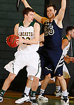 FEBRUARY 14, 2015 -- Riley Ryan #32 of Black Hills State looks past defender Joey Trinkle #25 of Colorado Christian during their Rocky Mountain Athletic Conference men's basketball game Saturday at the Donald E. Young Center in Spearfish, S.D.  (Photo by Dick Carlson/Inertia)