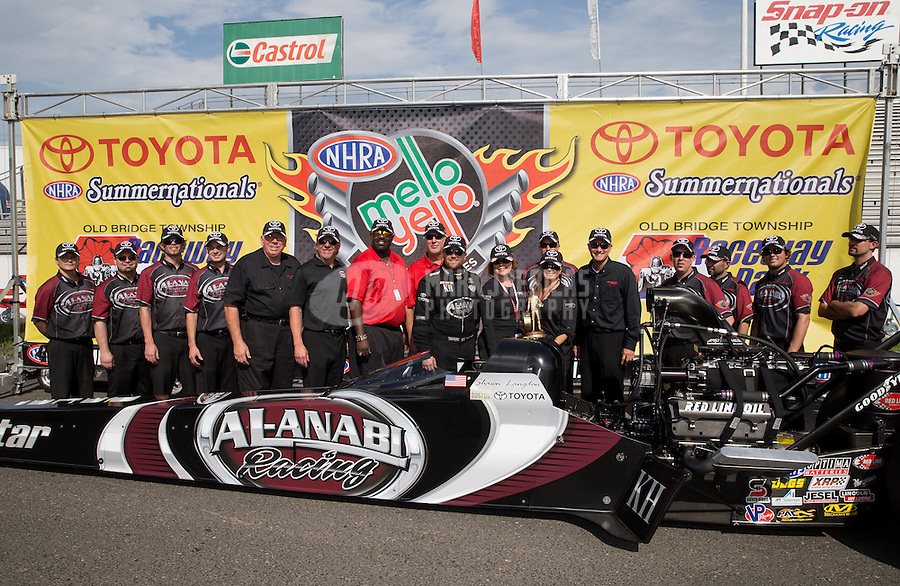 Jun. 2, 2013; Englishtown, NJ, USA: NHRA top fuel dragster driver Shawn Langdon celebrates with crew after winning the Summer Nationals at Raceway Park. Mandatory Credit: Mark J. Rebilas-