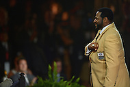 Canton, Ohio - August 6, 2015: Former NFL player Jerome Bettis acknowledges the audience as they applaud him after accepting his gold jacket during the 2015 Pro Football Hall of Fame enshrinement dinner in Canton, Ohio August 6, 2015. With eight 1,000 plus yard seasons, Bettis was tied for third-best in NFL history and his 13,662 career rushing yards ranked him fifth all-time. (Photo by Don Baxter/Media Images International)