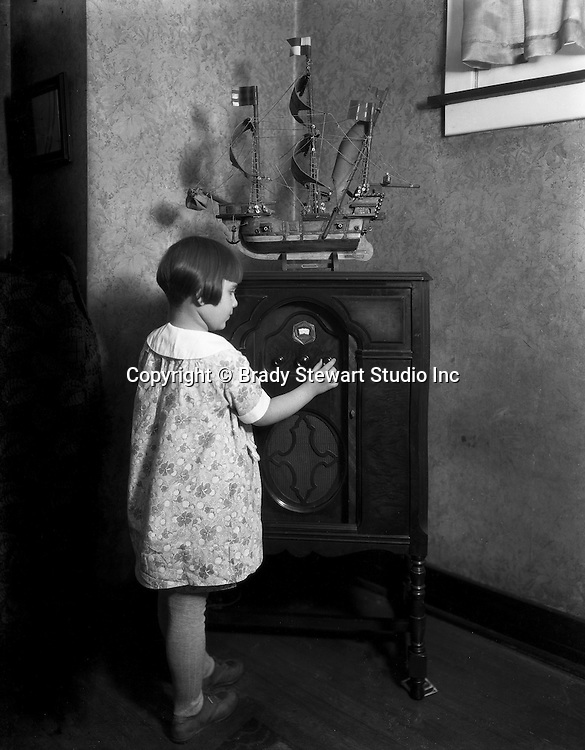 Pittsburgh PA:  Young girl listening to the 1924 Crosely Super Trirdyn Regular radio - 1925