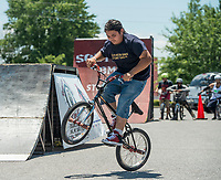 NWA Democrat-Gazette/BEN GOFF @NWABENGOFF<br /> Tyler Howell of Cleveland, Miss. performs flatland tricks Saturday, July 7, 2018, at a Southern BMX Stunt Show  performance during The Natural State Criterium Series in downtown Rogers. The third annual series produced by BikeNWA began with races in downtown Bentonville Friday evening. The series concludes Sunday in downtown Springdale with the first event starting at 8:50 a.m. and the final event starting at 4:00 p.m.