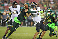 Tampa, FL - September 2, 2016: South Florida Bulls safety Malik Dixon (34) causes Towson Tigers quarterback Morgan Mahalak (6) to fumble the football during game between Towson and USF at the Raymond James Stadium in Tampa, FL. September 2, 2016.  (Photo by Elliott Brown/Media Images International)