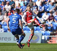 Fleetwood Town's David Ball controls the ball watched by Oldham Athletic's Anthony Gerrard<br /> <br /> Photographer Stephen White/CameraSport<br /> <br /> The EFL Sky Bet League One - Oldham Athletic v Fleetwood Town - Saturday 8th April 2017 - SportsDirect.com Park - Oldham<br /> <br /> World Copyright &copy; 2017 CameraSport. All rights reserved. 43 Linden Ave. Countesthorpe. Leicester. England. LE8 5PG - Tel: +44 (0) 116 277 4147 - admin@camerasport.com - www.camerasport.com