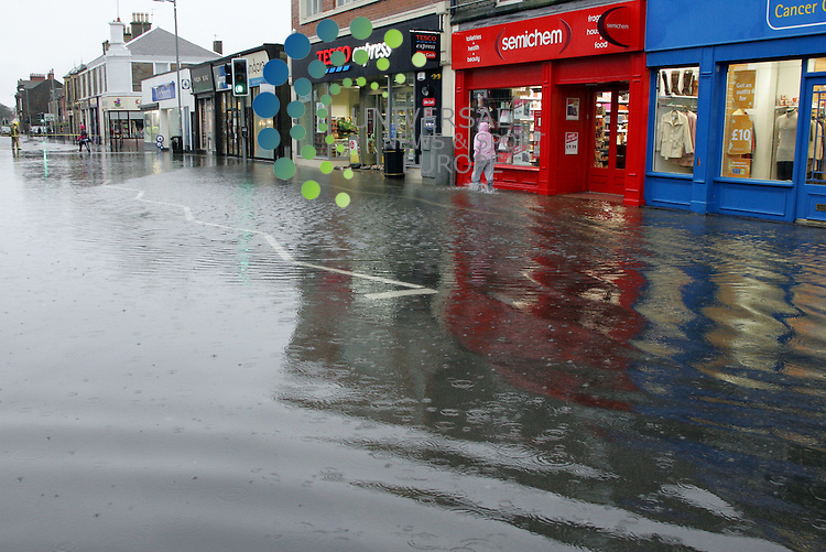 Troon's Portland Street is Flooded with water coming back up out of the drains. The only bit of dry road is  small rise at Troon Cross. A flooded Portland St. Picture: Universal News and Sport (Europe)17/10/2011