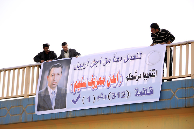 ERBIL, IRAQ:  Election workers hang a party sign for a Turkmen party on the first day of official election campaigning...Election workers start their campaigns for the Iraqi Parliamentary Elections due to be held March 7th, 2010...Photo by Refik Tekin/Metrography