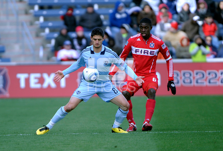 Sporting KC midfielder Milos Stojcev (88) plays the ball in front of Chicago Fire defender Jalil Anibaba (6).  The Chicago Fire defeated Sporting KC 3-2 at Toyota Park in Bridgeview, IL on March 27, 2011.