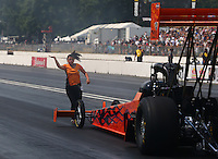 Aug. 2, 2014; Kent, WA, USA; A crew member guides NHRA top fuel dragster driver Mike Salinas back after his burnout during qualifying for the Northwest Nationals at Pacific Raceways. Mandatory Credit: Mark J. Rebilas-
