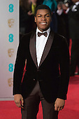 London, UK. 14 February 2016. Star Wars actor John Boyega. Red carpet arrivals for the 69th EE British Academy Film Awards, BAFTAs, at the Royal Opera House. © Vibrant Pictures/Alamy Live News