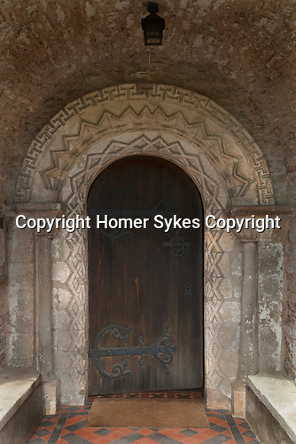 Norman arched doorway with ornamental zigzags forming lozenges on two faces of the round headed arch. Church of St Mary in Christon, North Somerset, England dates from the 12th century, built in 1170. HOMER SYKES