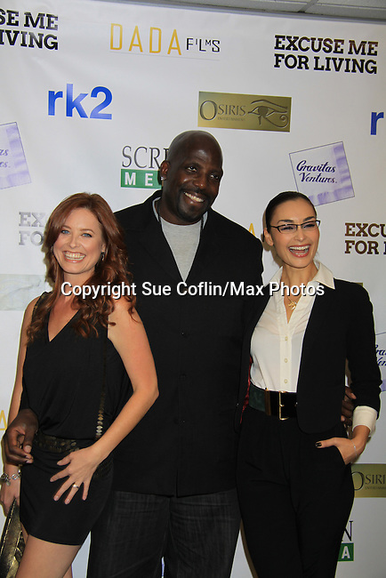 """One Life To Live Melissa Archer and As The World Turns Ewa Da Cruz pose with Kevin Brown and they all star in the film and are at the premiere of """"Excuse Me For Living"""" on October 12, 2012 at AMC Loews Village 7, New York City, New York.  (Photo by Sue Coflin/Max Photos)"""