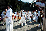 The crowd watches as Buddhist monks enter the ceremonial area during the Fire-walking Festival (Hiwatari-sai) at Mt. Takao on Sunday, March 12, 2017 in Hachioji, Japan.<br /> Photo by Kevin Clifford
