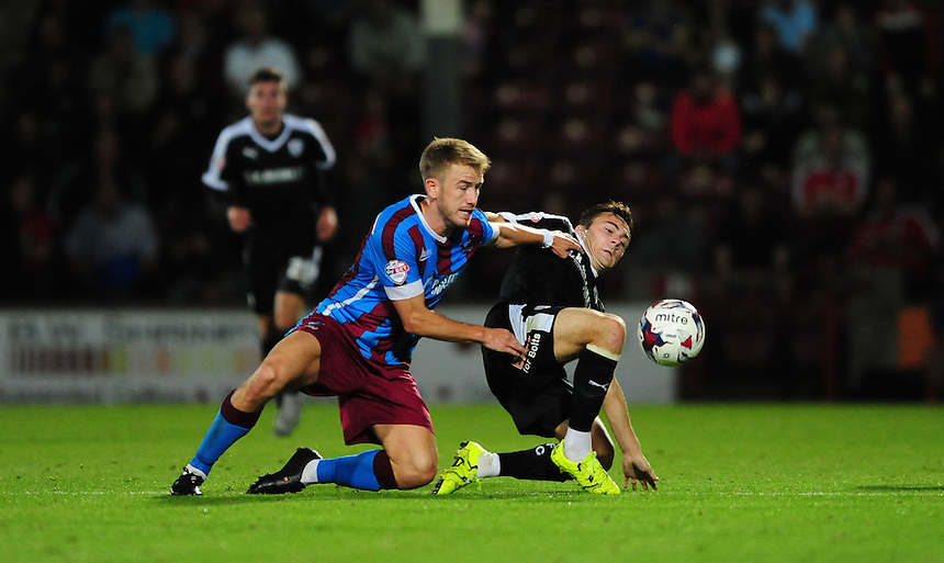 Scunthorpe United's Paddy Madden vies for possession with Barnsley's Josh Scowen<br /> <br /> Photographer Chris Vaughan/CameraSport<br /> <br /> Football - Capital One Cup First Round - Scunthorpe United v Barnsley - Tuesday 11th August 2015 - Glanford Park - Scunthorpe<br />  <br /> &copy; CameraSport - 43 Linden Ave. Countesthorpe. Leicester. England. LE8 5PG - Tel: +44 (0) 116 277 4147 - admin@camerasport.com - www.camerasport.com