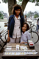 "Danang, February 1988. Ha and her mother in Danang. She is still seeking for her father: ""Michael Vernon Ysker, born in Minneapolis, Minnesota, in 1950, where are you Michael?"""