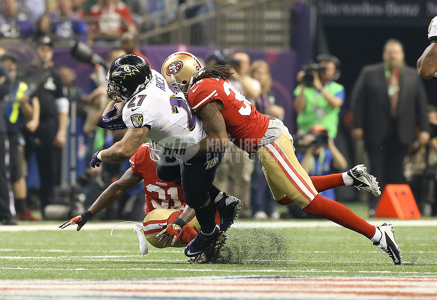 Feb 3, 2013; New Orleans, LA, USA; Baltimore Ravens running back Ray Rice (27) is tackled by San Francisco 49ers safety Dashon Goldson (38) in Super Bowl XLVII at the Mercedes-Benz Superdome. Mandatory Credit: Mark J. Rebilas-