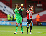 Simon Moore of Sheffield Utd and Jake Wright of Sheffield Utd  during the League One match at Bramall Lane Stadium, Sheffield. Picture date: September 17th, 2016. Pic Simon Bellis/Sportimage
