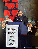 "United States Vice President George H.W. Bush speaks at the ""Campaign to the Summit"", a march on Washington, D.C. supporting freedom for Jews living in the Soviet Union, on Sunday, December 6, 1987.  200,000 people marched to focus attention on the repression of Soviet Jewry, was scheduled a day before United States President Ronald Reagan and Soviet President Mikhail Gorbachev began a 2 day summit in Washington where they signed the Intermediate Range Nuclear Forces (INF) Treaty.  Seated directly behind the Vice President is US Representative Jack Kemp (Republican of New York).<br />