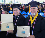 Veterans Phillip Jones, left, and Robert McCoy proudy show their diplomas during the 2015 Western Nevada College Commencement held at the Pony Express Pavilion in Carson City, Nev., on Monday, May 18, 2015.<br /> Photo by Tim Dunn