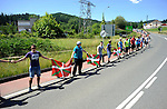 """People attend a human chain of 123 kilometres between the cities of Durango and Iruñea - Pamplona in the Basque Country with the slogan """"For the right to decide of the Basque Country - For a referendum on self determination"""" on June 8, 2014, in Ormaiztegi. More than 100.000 people attend the protest organised by """"Gure esku dago"""" (It´s in our hands) for the right to decide of the Basque Country. (Ander Gillenea / Bostok Photo)"""