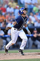 Asheville Tourists designated hitter Omar Carrizales (19) swings a pitch during a game against the Charleston RiverDogs on June 13, 2015 in Asheville, North Carolina. The Tourists defeated the RiverDogs 10-6. (Tony Farlow/Four Seam Images)