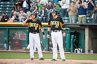 Alex Yarbrough (9) and Jett Bandy (27) of the Salt Lake Bees during the game against the Sacramento River Cats in Pacific Coast League action at Smith's Ballpark on April 20, 2015 in Salt Lake City, Utah.  (Stephen Smith/Four Seam Images)