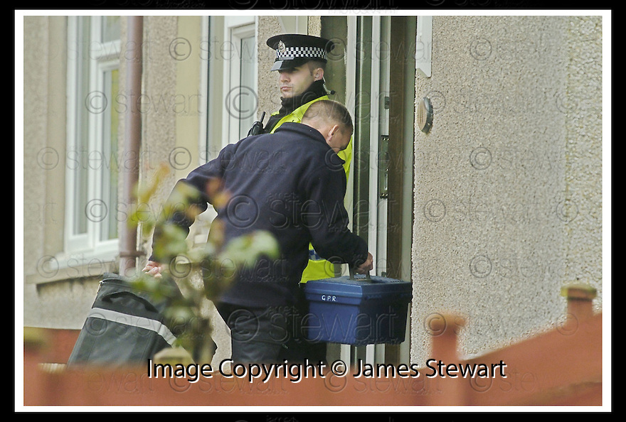 04/06/2007       Copyright Pic: James Stewart.File Name : sct_jspa11_tobin_house_0406.A POLICE OFFICER TAKES IN SOME TOOL BOXES INTO THE FORMER HOUSE OF PETER TOBIN IN ROBERTSON AVENUE, BATHGATE.......James Stewart Photo Agency 19 Carronlea Drive, Falkirk. FK2 8DN      Vat Reg No. 607 6932 25.Office     : +44 (0)1324 570906     .Mobile   : +44 (0)7721 416997.Fax         : +44 (0)1324 570906.E-mail  :  jim@jspa.co.uk.If you require further information then contact Jim Stewart on any of the numbers above.........
