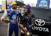 Feb 23, 2014; Chandler, AZ, USA; NHRA funny car driver Alexis DeJoria (right) celebrates with top fuel dragster driver Antron Brown after both won their classes at the Carquest Auto Parts Nationals at Wild Horse Motorsports Park. Mandatory Credit: Mark J. Rebilas-USA TODAY Sports