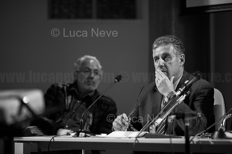 """(From L to R) Bongiovanni, Di Matteo.<br /> <br /> Rome, 08/02/19. Moby Dick Library in Garbatella & Antimafia Duemila(2.) held the presentation of the book """"Il Patto Sporco"""" (The Dirty Pact. The Trial State-mafia in the Story [narrated] by his Protagonist, Chiarelettere,1.) hosted by the author of the book Saverio Lodato (Journalist & Author), Antonino 'Nino' Di Matteo (Protagonist of the book, Antimafia Magistrate of Palermo, member of the DNA - Antimafia & Antiterrorism National Directorate - who """"prosecuted the Italian State for conspiring with the Mafia in acts of murder & terror"""",3.4.5.6.) & Giorgio Bongiovanni (Editor of Antimafia Duemila). Chair of the event was Silvia Resta (Journalist & Author). Readers were: Bianca Nappi & Carlotta Natoli (both Actresses). From the back cover of the book: """"Let us ask ourselves why politics, institutions, culture, have needed the words of judges to finally begin to understand…A handful of magistrates and investigators have shown not to be afraid to prosecute the [Italian] State. Now others must do their part too"""" (Nino Di Matteo). """"In the pages of this book I wanted the magistrate, the man, the protagonist and the witness to speak about a trial destined to leave its mark"""" (Saverio Lodato). From the book online page: """"The attacks to Lima [politician], Falcone & Borsellino [Judges], the bombs in Milan, Florence, Rome, the murders of valiant police commissioners & officers of the carabinieri. The [Ita] State on its knees, its best men sacrificed. However, while the blood of the massacres was still running there were those who, precisely in the name of the State, dialogued and interacted with the enemy. The sentence of condemnation of Palermo [""""mafia-State negotiation"""" trial which is told in the book], against the opinion of many 'deniers', proved that the negotiation not only was there but did not avoid more blood. On the contrary, it provoked it""""(1.).<br /> Footnotes & links provided at 2nd & last page."""