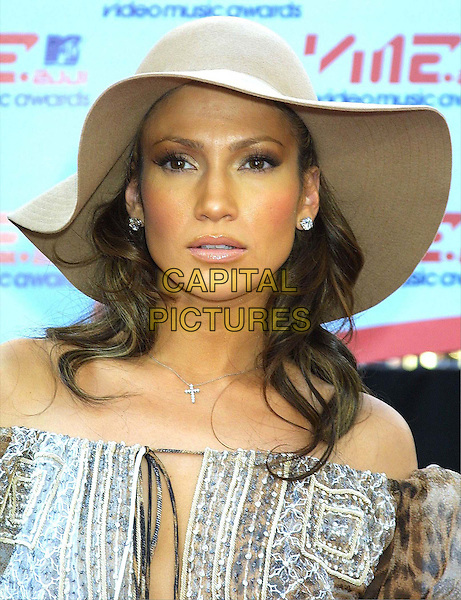 JENNIFER LOPEZ .MTV Video Music Awards .off the shoulder top, cross, crucifix, hat, headshot, portrait, j lo.www.capitalpictures.com.sales@capitalpictures.com.©Capital Pictures
