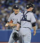 Masahiro Tanaka, Brian McCann (Yankees),<br /> APRIL 4, 2014 - MLB : Pitcher Masahiro Tanaka (L) of the New York Yankees talks with catcher Brian McCann during the Major League Baseball game against the Toronto Blue Jays at Rogers Centre in Toronto, Ontario, Canada.<br /> (Photo by AFLO)