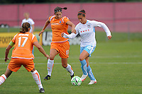 Carli Lloyd (10) of the Chicago Red Stars is marked by Yael Averbuch (10) of Sky Blue FC. Sky Blue FC defeated the Chicago Red Stars 1-0 during a Women's Professional Soccer match at Yurcak Field in Piscataway, NJ, on June 17, 2009.