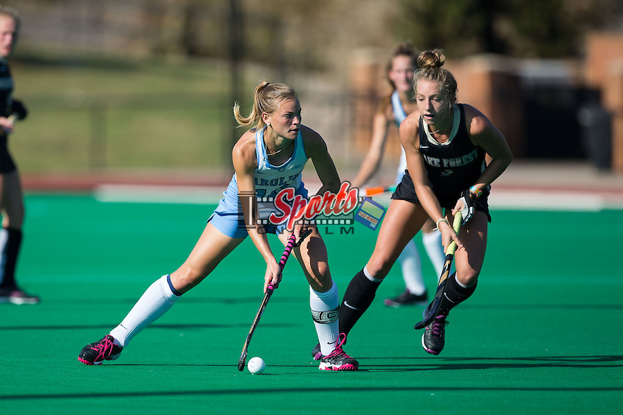 Julia Young (16) of the North Carolina Tar Heels works to keep the ball away from Emily Adamson (9) of the Wake Forest Demon Deacons during first half action at Kentner Stadium on October 23, 2015 in Winston-Salem, North Carolina.  The Demon Deacons defeated the Tar Heels 3-2.  (Brian Westerholt/Sports On Film)