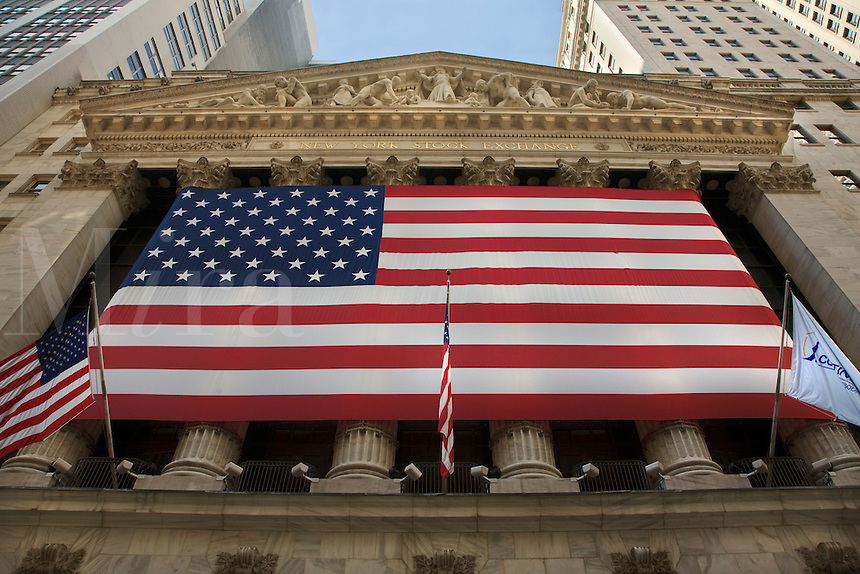 Large AMERICAN FLAG in front of the NYSE - NEW YORK CITY
