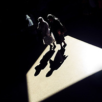 Colombian nuns walk through a beam of light thrown on the platform of San Antonio metro station in Medellín, Colombia, 13 December 2016.