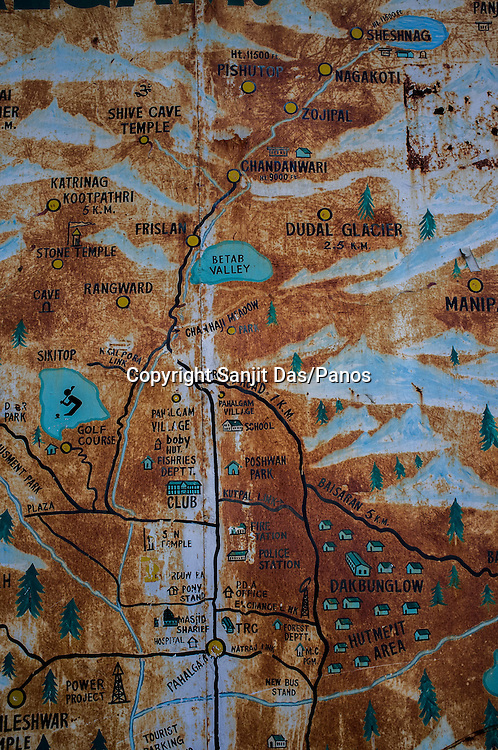 A rusty hand painted map seen in the centre of Pahalgam town in Kashmir, India. Hindu pilgrims make their first stop in Pahalgam before making their pilgrimage to reach the sacred Amarnath cave, which houses a lingam - a stylized phallus, worshiped by Hindus as a symbol of God Shiva. Photo: Sanjit Das/Panos