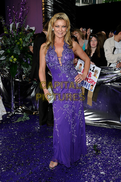 CLAIRE KING.of Emmerdale.Attending the British Soap Awards 2008.BBC Television Centre, Wood Lane, London, England, 3rd May 2008.full length Clare purple patterned dress hand on hip cleavage low cut .CAP/CAN.©Can Nguyen/Capital Pictures