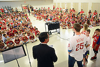 Phillies outfielder Cody Asche speaks with Barclay Elementary School students during a special assembly Wednesday June 17, 2015 in Warrington, Pennsylvania. Liam and Kate Petersen's parents won the unique experience through the Phillies Charities, Inc. Phantastic Auction. (Photo by William Thomas Cain)
