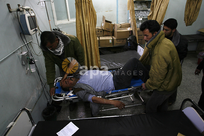 A Palestinian wounded arrive in hospital after an Israeli airstrike in Rafah, southern Gaza Strip, Saturday, March 10, 2012. The airstrike killed Popular Resistance Committees militant Mahdi Abu Shawesh. Despite Egyptian efforts to mediate a cease-fire, both sides remained defiant with Palestinians firing more than 100 rockets, some striking major cities in southern Israel, and the military responding with the targeted killings of more than 15 militants.  Photo by Abed Rahim Khatib