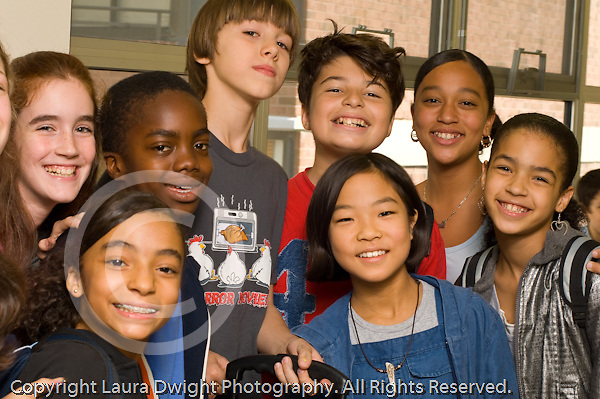 Public School  Middle School happy group of children posing in corridor horizontal