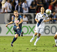 CARSON, CA - July 4, 2012: Philadelphia Union midfielder Brain Carroll (7) and LA Galaxy forward Landon Donovan (10) during the LA Galaxy vs Philadelphia Union match at the Home Depot Center in Carson, California. Final score LA Galaxy 1, Philadelphia Union 2.