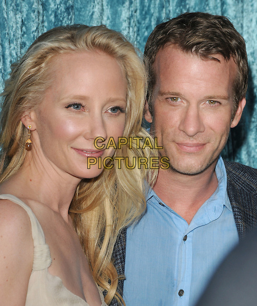 ANNE HECHE & THOMAS JANE.The HBO Premiere of 2nd Season of Hung held at Paramount Picture Studios in Hollywood, California, USA..June 23rd, 2010.headshot portrait beige cream blue grey gray.CAP/RKE/DVS.©DVS/RockinExposures/Capital Pictures.
